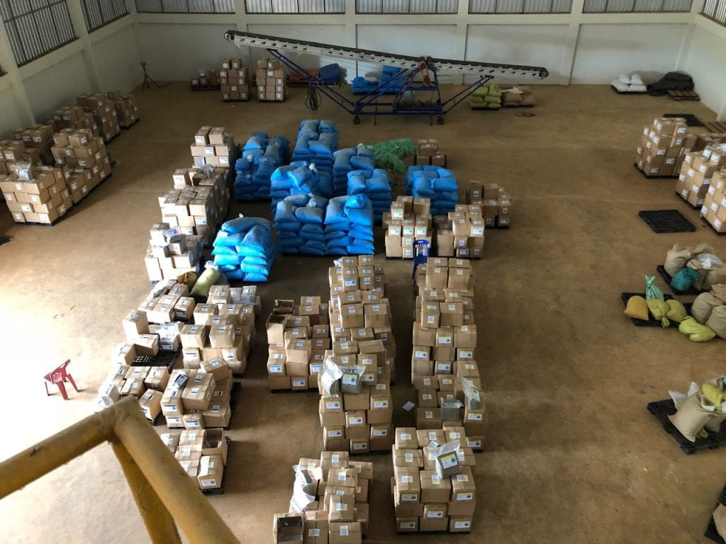 Bags and boxes of green coffee stored in a warehouse