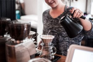A-barista-prepares-multiple-pour-over-coffees