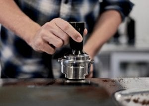 Barista gets ready to tamp